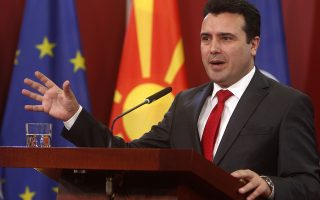 Macedonian Prime Minister Zoran Zaev gestures during a news conference in the government building in Skopje, Macedonia, Saturday, Jan. 12, 2019. Macedonia late Friday fulfilled its part of a historic deal that will pave its way to NATO membership and normalize relations with neighboring Greece, after lawmakers approved constitutional changes to rename the country North Macedonia. (AP Photo/Boris Grdanoski)