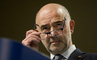 European Commissioner for Economic and Financial Affairs Pierre Moscovici speaks during a media conference at EU headquarters in Brussels, Wednesday, Dec. 19, 2018. Economists say leaving the EU without a deal risks plunging the British economy into recession and touching off chaos at the borders. The EU was set Wednesday to publish documents on its own preparations for a no-deal Brexit. (AP Photo/Virginia Mayo)