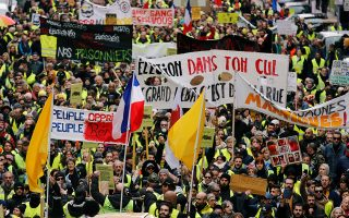 Protesters wearing yellow vests take part in a demonstration of the