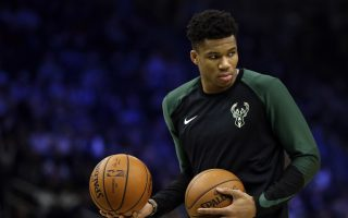 Milwaukee Bucks' Giannis Antetokounmpo warms up before the second half of an NBA basketball game against the Washington Wizards Wednesday, Feb. 6, 2019, in Milwaukee. (AP Photo/Aaron Gash)