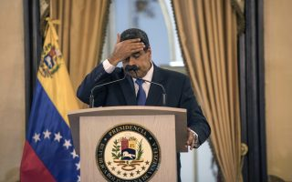 Venezuela's President Nicolas Maduro touches his forehead during a press conference at Miraflore's Presidential Palace in Caracas, Venezuela, Friday, Feb. 8, 2019. U.S. humanitarian aid destined for Venezuela was being prepared at a warehouse on the Colombian border Friday, as opposition leader Juan Guaido assured his desperate countrymen that supplies would reach them despite objections from embattled President Nicolas Maduro. (AP Photo/Rodrigo Abd)