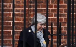 Britain's Prime Minister Theresa May leaves 10 Downing Street in London, Tuesday, Feb. 5, 2019. Britain is due to leave the EU on March 29, with or without a Brexit deal.(AP Photo/Frank Augstein)