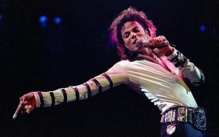 FILE - In this Feb. 24, 1988 file photo, Michael Jackson leans, points and sings, dances and struts during the opening performance of his 13-city U.S. tour, in Kansas City, Mo. The owners of technology used to create holograms of deceased celebrities on Thursday May 15, 2014, sued Jackson's estate and the producers of Sunday's Billboard Music Awards trying to block any use of their technology to generate a Jackson hologram during the show. (AP Photo/Cliff Schiappa, file)