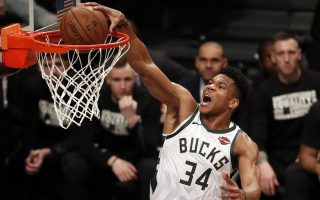 epa07344165 Milwaukee Bucks forward Giannis Antetokounmpo dunks the ball past the Brooklyn Nets defense in the first half of the game between the Milwaukee Bucks and the Brooklyn Nets at Barclays Center in Brooklyn, New York, USA, 04 February 2019.  EPA/JASON SZENES  SHUTTERSTOCK OUT