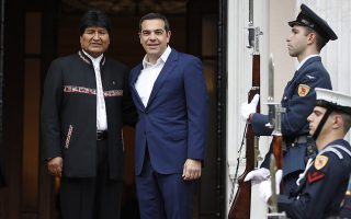 Greece's Prime Minister Alexis Tsipras, right, welcomes Bolivia's President Evo Morales at Maximos Mansion in Athens, Friday, March 15, 2019. Bolivia's left-wing president on Thursday compared Venezuelan opposition leader Juan Guaido to an erstwhile colonial viceroy and spoke out against any military intervention in the troubled country. (AP Photo/Thanassis Stavrakis)