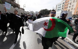 epaselect epa07419367 Algerian lawyers chant slogans during their protest against the fifth term bid of Algerian President Abdelaziz Bouteflika, in Algiers, Algeria, 07 March 2019. Bouteflika, serving as the president since 1999, submitted on 03 March his re-election candidacy papers to the Constitutional Council, despite the mystery surrounding his health status as well as continuing protests against his plans to seek a fifth term in office.  EPA/MOHAMED MESSARA