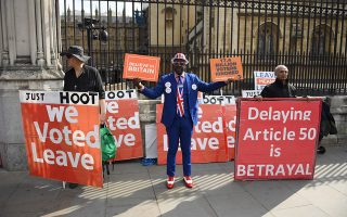 epa07468459 A pro Brexit supporter outside the Houses of Parliament in London, Britain, 28 March 2019. Reports state that British Prime Minister Theresa May told a meeting of Conservative backbenchers on 27 March 2019 she would leave office earlier than planned if it guaranteed Parliament's backing for her withdrawal agreement with the EU.  EPA/NEIL HALL