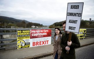 People attend a protest against Brexit at the border crossing between the Republic of Ireland and Northern Ireland in Carrickcarnon, Ireland March 30. 2019. REUTERS/Clodagh Kilcoyne