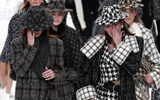 epa07414654 Crying models pay tribute to the late German designer Karl Lagerfeld after the presentation of the Fall/Winter 2019/20 Women's collection of Chanel fashion house during the Paris Fashion Week, in Paris, France, 05 March 2019. Karl Lagerfeld died aged 85 on 19 February 2019. His final collection for Chanel is presented at the Grand Palais on the last day of the Paris Fashion Week.  EPA/IAN LANGSDON