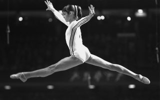 ** FILE ** Nadia Comaneci performs on the horse vault at the Summer Olympics in Montreal, in this July 18, 1976 photo. Comaneci defended her perfect 10s in gymnastics at the Montreal Games, last week at the gymnastics European Chmapionships in Amsterdam, Netherlands,  after a top Olympic official said the scores were inflated. (AP Photo)