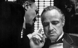**FILE** Bonasera, portrayed by Frank Puglia, asks Don Vito Corleone, portrayed by Marlon Brando, right, for a favor in a scene from the 1972 movie