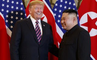 In this Feb. 27, 2019, photo, President Donald Trump, left, meets North Korean leader Kim Jong Un, in Hanoi. (AP Photo/ Evan Vucci, File)