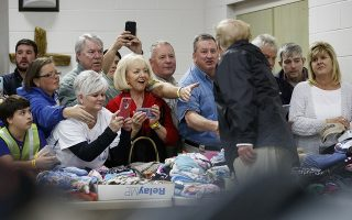 President Donald Trump greets people at Providence Baptist Church in Smiths Station, Ala., Friday, March 8, 2019, during a tour of areas where tornados killed 23 people in Lee County, Ala. (AP Photo/Carolyn Kaster)