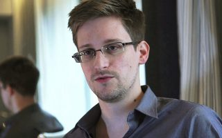 NSA whistleblower Edward Snowden, an analyst with a U.S. defence contractor, is seen in this still image taken from video during an interview by The Guardian in his hotel room in Hong Kong June 6, 2013. Snowden has not yet formally accepted asylum in Venezuela, the anti-secrecy group WikiLeaks said on July 9, 2013 after a Russian lawmaker posted a statement to that effect on Twitter and then deleted it. WikiLeaks, on its own Twitter feed, said that states involved in a decision on an asylum destination for Snowden, who is believed to be holed up at a Moscow airport,