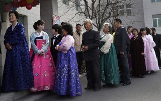 People line up to vote during the election at a polling station in Pyongyang, North Korea, Sunday, March 10, 2019. Millions of North Korean voters, including leader Kim Jong Un, are going to the polls to elect roughly 700 members to the national legislature. In typical North Korean style, voters are presented with just one state-sanctioned candidate per district and they cast ballots to show their approval or, very rarely, disapproval. (AP Photo/Dita Alangkara)