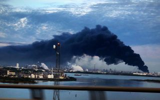 Smoke rises from a fire burning at the Intercontinental Terminals Company in Deer Park, east of Houston, Texas, U.S., March 18, 2019. Jaimie Meldrum/@jamiejow/Handout via REUTERS  ATTENTION EDITORS - THIS IMAGE WAS PROVIDED BY A THIRD PARTY.  NO RESALES. NO ARCHIVES.