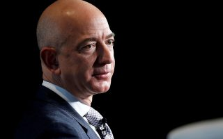 FILE PHOTO: Jeff Bezos, founder of Blue Origin and CEO of Amazon, speaks about the future plans of Blue Origin during an address to attendees at Access Intelligence's SATELLITE 2017 conference in Washington, U.S., March 7, 2017. REUTERS/Joshua Roberts/File Photo