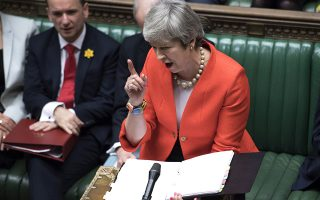 Britain's Prime Minister Theresa May speaks to lawmakers in parliament, London, Wednesday Feb. 27, 2019.  May insisted Wednesday that Britain will leave the European Union on schedule next month, amid signs that her promise to give Parliament a vote on delaying Brexit was boosting support for her unpopular EU divorce deal. (Jessica Taylor/UK Parliament via AP)