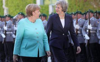 epaselect epa05433584 German chancellor Angela Merkel (L) receives British Prime Minister Theresa May at the Chancellery inBerlin, Germany, 20 July 2016.  EPA/MICHAEL KAPPELER