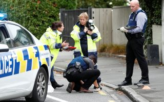 Forensic investigators work outside Linwood mosque in Christchurch, New Zealand, March 17, 2019. REUTERS/Edgar Su