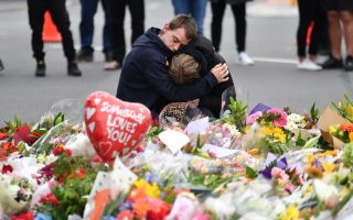 epaselect epa07441388 Members of the public mourn at a flower memorial near the Al Noor Masjid on Deans Rd in Christchurch, New Zealand, 16 March 2019. A gunman killed 49 worshippers at the Al Noor Masjid and Linwood Masjid on 15 March. The 28-year-old Australian suspect, Brenton Tarrant, appeared in court on 16 March and was charged with murder.  EPA/MICK TSIKAS  AUSTRALIA AND NEW ZEALAND OUT