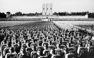 File --Nearly 100,000 Nazi Storm Troopers are gathered at Luitpold arena to listen to a speech by Reichs Fuehrer Adolf Hitler on