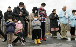 People pray to mourn victims at 2:46 PM (05:46 GMT), the time when the magnitude 9.0 earthquake struck off Japan's coast in 2011, in Iwaki, Fukushima prefecture, Japan March 11, 2019, to mark the eighth year anniversary of the earthquake and tsunami that killed thousands and set off a nuclear crisis. Kyodo/via REUTERS   ATTENTION EDITORS - THIS IMAGE HAS BEEN SUPPLIED BY A THIRD PARTY. MANDATORY CREDIT. JAPAN OUT. NO COMMERCIAL OR EDITORIAL SALES IN JAPAN.