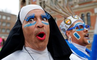 People wear local carnival costumes during the parade of