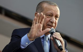 Turkey's President Recep Tayyip Erdogan addresses the supporters of his ruling Justice and Development Party, AKP, during a rally in Ankara, Turkey, Thursday, March 14, 2019, ahead of local elections scheduled for March 31, 2019. (AP Photo/Burhan Ozbilici)