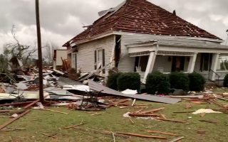 Debris and a damaged house seen following a tornado in Beauregard, Alabama, U.S. in this March 3, 2019 still image obtained from social media video. SCOTT FILLMER /via REUTERS   ATTENTION EDITORS - THIS IMAGE HAS BEEN SUPPLIED BY A THIRD PARTY. MANDATORY CREDIT. NO RESALES. NO ARCHIVES. MUST CREDIT SCOTT FILLMER. TV MUST ON SCREEN COURTESY SCOTT FILLMER.