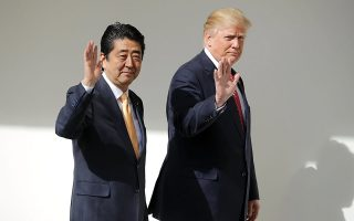 epa05783878 US President Donald Trump (R) and Japan Prime Minister Shinzo Abe (L) walk together to their joint press conference in the East Room at the White House in Washington, DC, USA, 10 February 2017. Trump and Abe are expected to discuss many issues, including trade and security ties and will hold a joint press confrence later in the day.  EPA/Chip Somodevilla / POOL AFP OUT