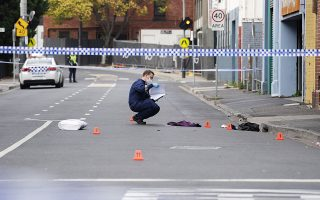 A Victoria Police personnel works at the scene of a multiple shooting outside Love Machine nightclub in Prahran, Melbourne, Australia April 14, 2019. AAP Image/Ellen Smith/via REUTERS   ATTENTION EDITORS - THIS IMAGE WAS PROVIDED BY A THIRD PARTY. NO RESALES. NO ARCHIVE. AUSTRALIA OUT. NEW ZEALAND OUT. NO COMMERCIAL OR EDITORIAL SALES IN NEW ZEALAND. NO COMMERCIAL OR EDITORIAL SALES IN AUSTRALIA.