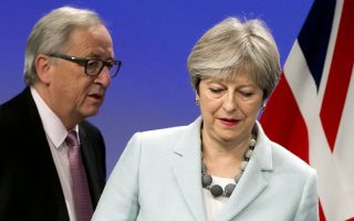 FILE - In this Dec. 8, 2017 file photo, British Prime Minister Theresa May, right, and European Commission President Jean-Claude Juncker prepare to address a media conference at EU headquarters in Brussels. EU leaders will confront May for the second time in three weeks on her government's plans at an emergency Brexit summit on Wednesday, April 10, 2019, and such gatherings aren't getting any friendlier. (AP Photo/Virginia Mayo, File)