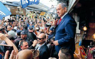 O πρόεδρος του κόμματος Λικούντ και πρωθυπουργός του Ισραήλ Μπέντζαμιν Νετανιάχου μιλάει σε οπαδούς του, μία ημέρα πριν από τις εκλογές της 9ης Απριλίου, στις οποίες ανεδείχθη νικητής. EPA/ABIR SULTAN