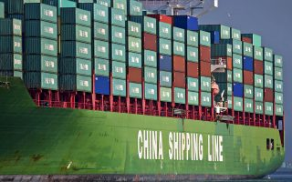 A loaded China Shipping container ship makes its way down the main channel at the Port of Los Angeles in Los Angeles, California, U.S., on Tuesday, Nov. 11, 2008. The U.S. trade deficit in September narrowed more than forecast as a record decline in the cost of foreign crude oil caused fuel imports to tumble. Photographer: Tim Rue/Bloomberg News
