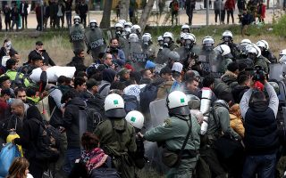 epa07486696 Riot policemen clash with refugees and migrants during a rally near a refugee camp in the village of Diavata, west of Thessaloniki, in northern Greece, 05 April 2019. The gathered refugees packed up their tents and belongings and started moving towards the police vans that had set up a perimeter around the Diavata centre, asking police to let them pass and head towards the borders. The police officers responded by using tear gas and flash-bang grenades to push them back and the refugees retreated, after setting fire to garbage that had been left in the field. Currently, the refugees are attempting to get through the police cordon by other routes but the entire area is being closely guarded by police forces.  EPA/SOTIRIS BARBAROUSIS