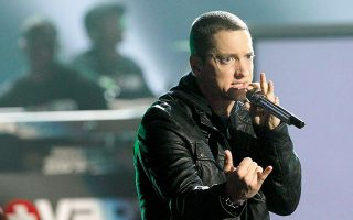 Rapper Eminem performs 'Not Afraid' at the 2010 BET Awards in Los Angeles June 27, 2010. REUTERS/Mario Anzuoni (UNITED STATES - Tags: ENTERTAINMENT)