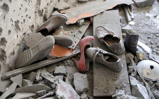 FILE PHOTO: Shoes are pictured in a house damaged by shelling during the fighting between the eastern forces and internationally recognized government is pictured in Abu Salim in Tripoli, Libya April 15, 2019. REUTERS/Hani Amara/File Photo