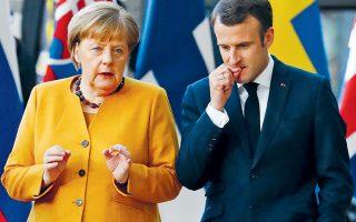 Η λύση Γάλλων και Αμερικανών για το Κόσοβο προβλέπει ανταλλαγή εδαφών, κάτι που δεν βρίσκει σύμφωνους τους Γερμανούς, οι οποίοι φοβούνται βαλκανικό ντόμινο (στη φωτογραφία, Αγκελα Μέρκελ και Εμανουέλ Μακρόν).