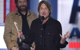 Keith Urban, right, accepts the award for entertainer of the year, as presenter Ronnie Dunn, of Brooks & Dunn, looks on at the 54th annual Academy of Country Music Awards at the MGM Grand Garden Arena on Sunday, April 7, 2019, in Las Vegas. (Photo by Chris Pizzello/Invision/AP)
