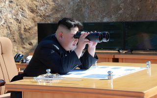 North Korean Leader Kim Jong Un looks on during the test-fire of inter-continental ballistic missile Hwasong-14 in this undated photo released by North Korea's Korean Central News Agency (KCNA) in Pyongyang, July, 4 2017. KCNA/via REUTERS ATTENTION EDITORS - THIS IMAGE WAS PROVIDED BY A THIRD PARTY. REUTERS IS UNABLE TO INDEPENDENTLY VERIFY THIS IMAGE. NO THIRD PARTY SALES. SOUTH KOREA OUT.     TPX IMAGES OF THE DAY