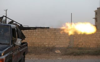 Members of the Libyan internationally recognised government forces fire during fighting with Eastern forces in Ain Zara, Tripoli, Libya April 20, 2019. REUTERS/Hani Amara