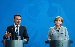 epa06549946 Prime Minister of the former Yugoslav Republic of Macedonia Zoran Zaev (L) and German Chancellor Angela Merkel talk to media during a joint press conference at the Chancellery in Berlin, Germany, 21 February 2018. The first bilateral meeting between Zaev and German Chancellor Merkel took place on the sidelines of the EU-Western Balkans Summit in July 2017.  EPA/HAYOUNG JEON