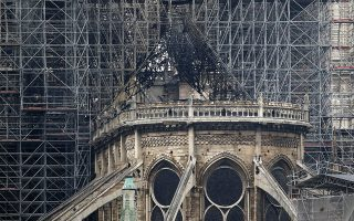 View of the scaffolding and damaged Notre Dame cathedral after the fire in Paris, Tuesday, April 16, 2019. Experts are assessing the blackened shell of Paris' iconic Notre Dame cathedral to establish next steps to save what remains after a devastating fire destroyed much of the almost 900-year-old building. With the fire that broke out Monday evening and quickly consumed the cathedral now under control, attention is turning to ensuring the structural integrity of the remaining building. (AP Photo/Christophe Ena)