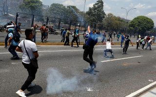 Opposition demonstrators clash with security forces near the Generalisimo Francisco de Miranda Airbase