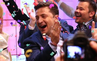 epaselect epa07520360 Ukrainian Presidential candidate Volodymyr Zelensky (C) reacts at the briefing after the announcement of exit-poll during the Ukrainian presidential elections in Kiev, Ukraine, 21 April 2019. Ukrainians vote in the second round of Presidential elections on 21 April 2019. After the first round of elections, showman Volodymyr Zelensky is a frontrunner with 30.24 percent of votes and incumbent president Petro Poroshenko is a runner-up with 15.95 percent of votes.  EPA/TATYANA ZENKOVICH