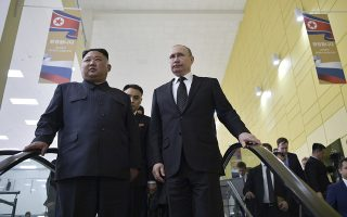 Russian President Vladimir Putin, right, and North Korea's leader Kim Jong Un take an escalator leaving a hall after the talks in Vladivostok, Russia, Thursday, April 25, 2019. Russian President Vladimir Putin and North Korean leader Kim Jong Un said Thursday they had good talks about their joint efforts to resolve a standoff over Pyongyang's nuclear program, amid stalled negotiations with the United States.(Alexei Nikolsky, Sputnik, Kremlin Pool Photo via AP)