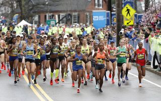 Apr 15, 2019; Boston, MA, USA; Mare Dibaba (ETH) and Biruktayit Eshetu (ETH) lead the pack at the elite women's start during the 2019 Boston Marathon. Mandatory Credit: Greg M. Cooper-USA TODAY Sports