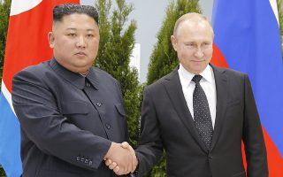 epa07526545 Russian President Vladimir Putin (R) and North Korean leader Kim Jong-un shake hands while posing for a photograph during their meeting in Vladivostok, Russia, 25 April 2019. Putin and Kim are set to have one-on-one meeting at the Far Eastern State University on the Russky Island across a bridge from Vladivostok. The meeting will be followed by broader talks involving officials from both nations.  EPA/ALEXANDER ZEMLIANICHENKO / POOL