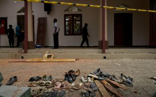 Footwear and personal belongs of victims kept close to the scene of a suicide bombing at St. Sebastian Church in Negombo, Sri Lanka, Monday, April 22, 2019. Easter Sunday bombings of churches, luxury hotels and other sites was Sri Lanka's deadliest violence since a devastating civil war in the South Asian island nation ended a decade ago. (AP Photo/Gemunu Amarasinghe)